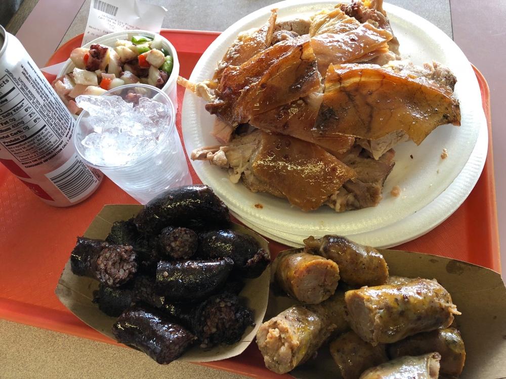 Lechón, morcilla and pork sausage at a lechonera in Puerto Rico